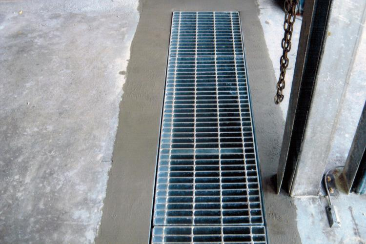 Industrial drain installation completed.