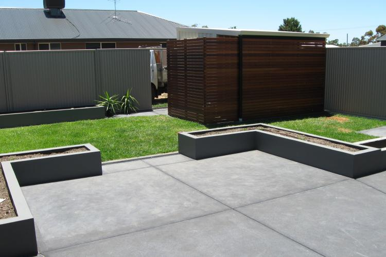 Robert concreted the back yard floor and plantar boxes.
