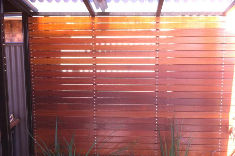 Outdoor wooden slats feature wall