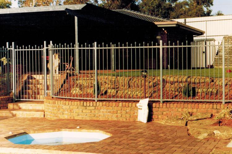 Backyard fence and paving.