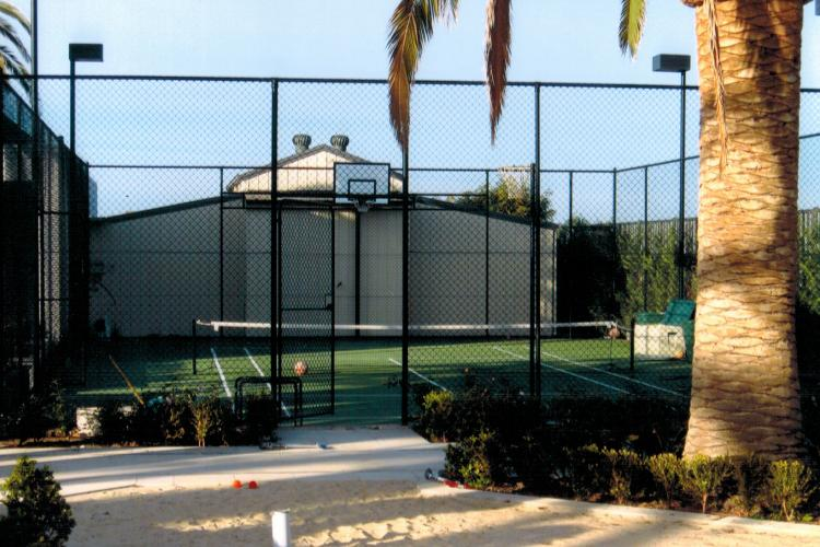 Robert repaired the old tennis court, as well as adding new lighting and fencing.